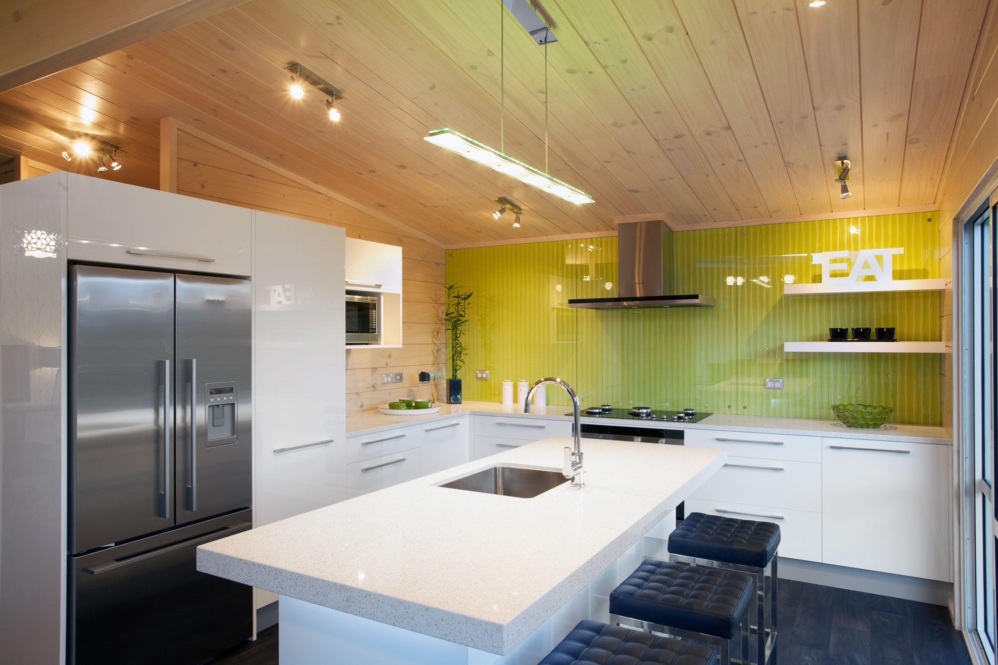 Bright green splashback in a Lockwood open plan kitchen