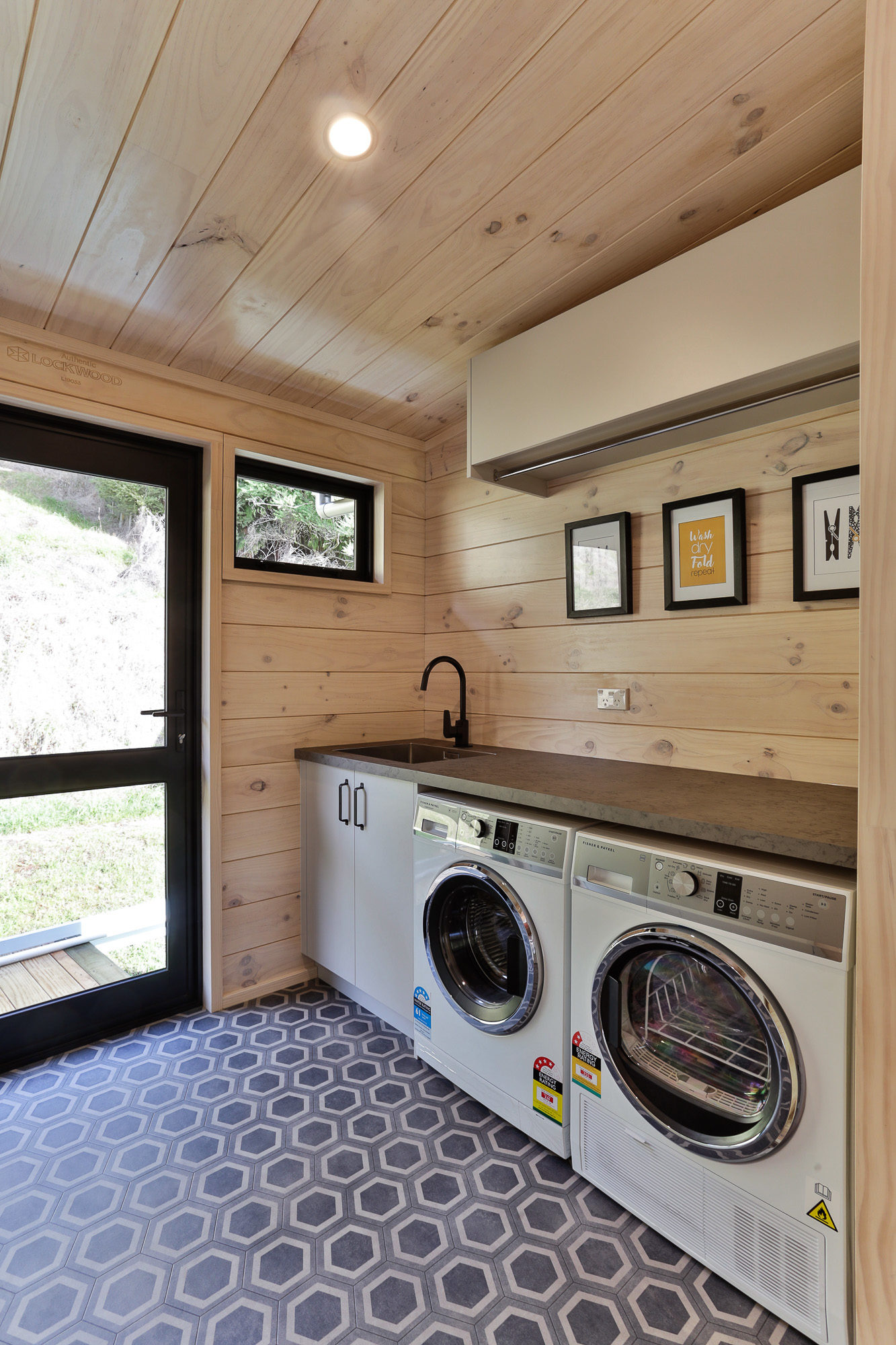 Lockwood Laundry with benchtop and high cupboards